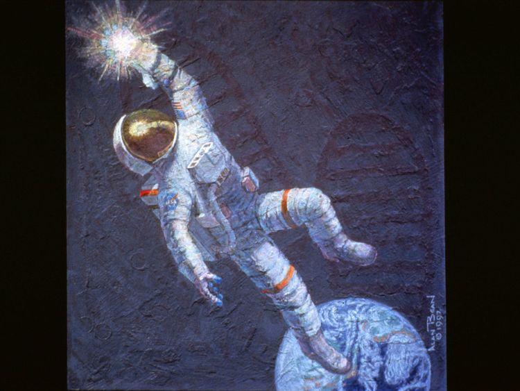 """Cette fresque,"""" Atteindre les étoiles """", est l'une des nombreuses oeuvres Astronaut Alan Bean a été chargé de peindre après avoir réussi la transition d'un astronaute à un artiste professionnel à temps plein en 1981"""