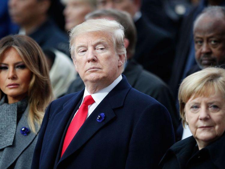 Le président Trump avec sa femme et le chancelier allemand à Paris