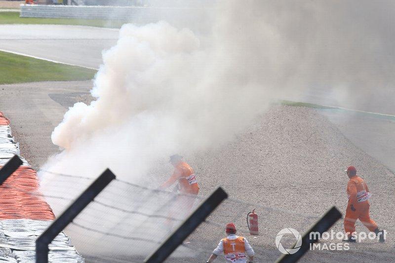 Andrea Dovizioso, vélo Ducati Team en flammes