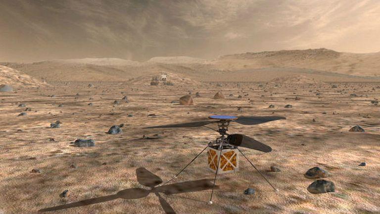 Une vue d'artiste de l'hélicoptère de Mars sur la planète rouge.  Pic: NASA