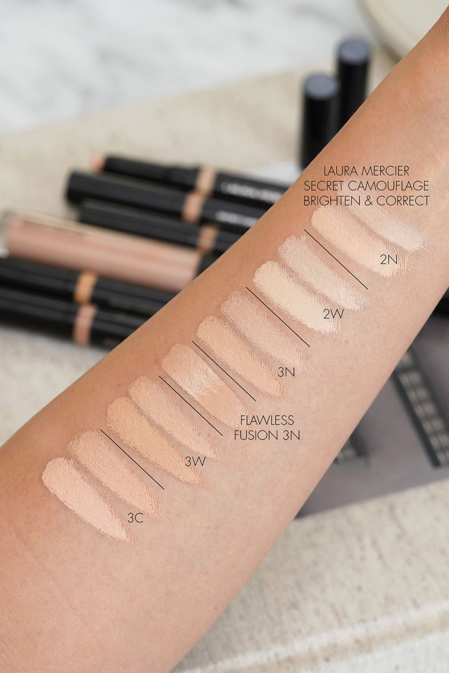 Laura Mercier Secret Camouflage Correct and Brighten Concealer Duo Swatches 2 and 3 family