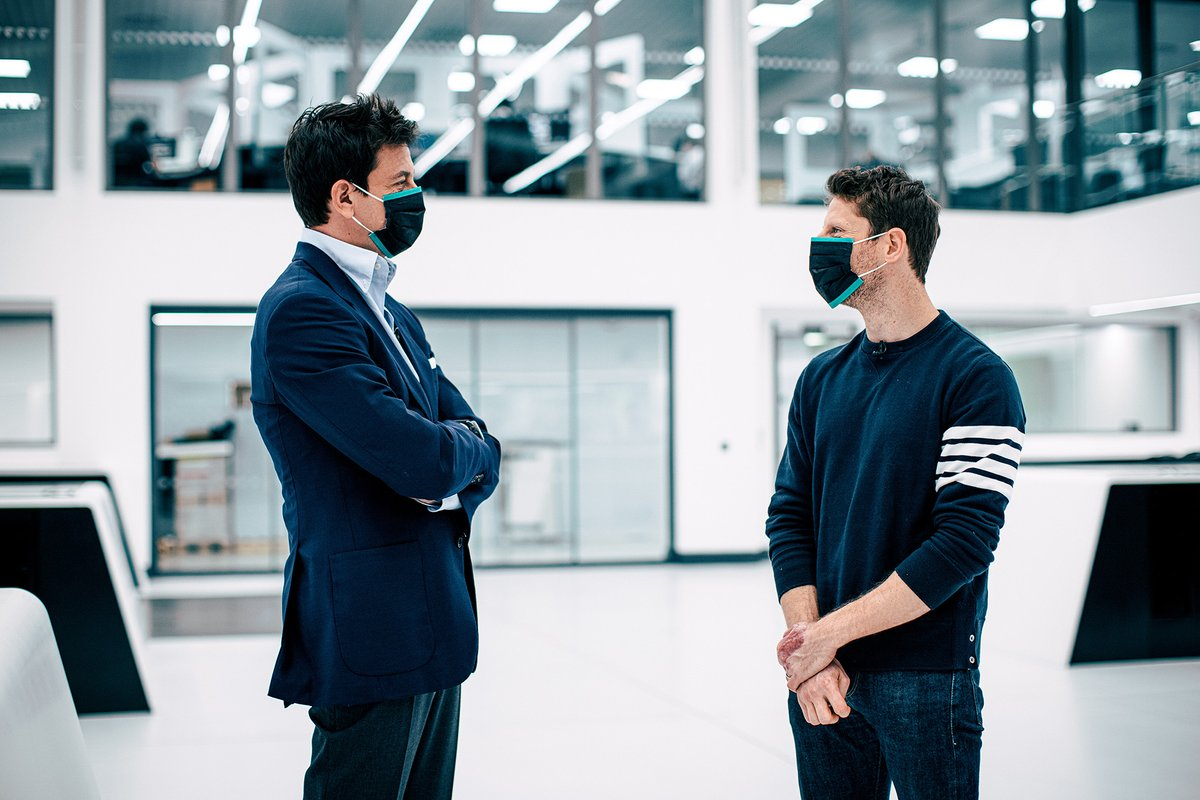 Toto Wolff, directeur exécutif (affaires), Mercedes AMG et Romain Grosjean, Mercedes